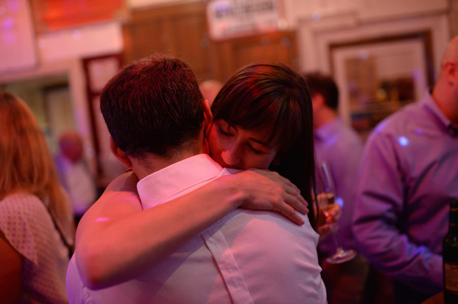 wedding couple hugging at party