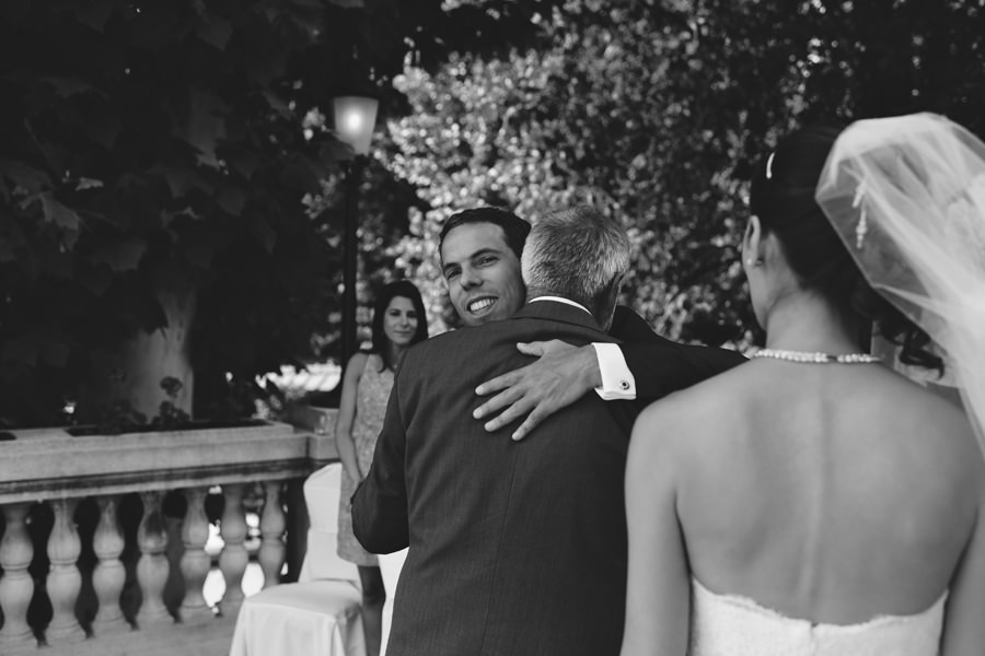 groom hugs bride's father