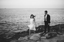 black and white engagement portrait photo in Valletta by the sea