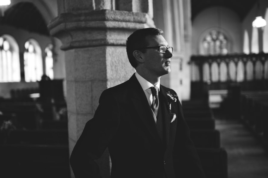 Groom waiting for bride in Church, Cornwall, England