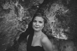 black and white women portrait with rock