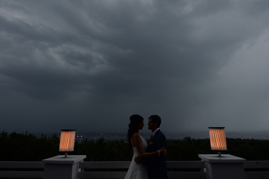 Wedding couple with stormy clouds