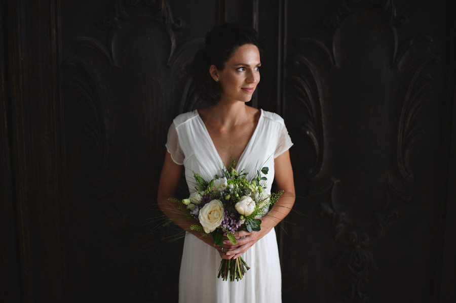 bride portrait in front of wooden door