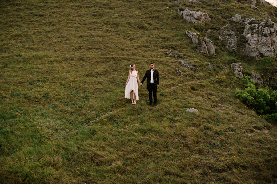 wedding portrait on a side of a hill