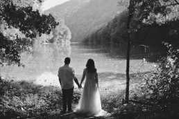 black and white wedding portrait with lake