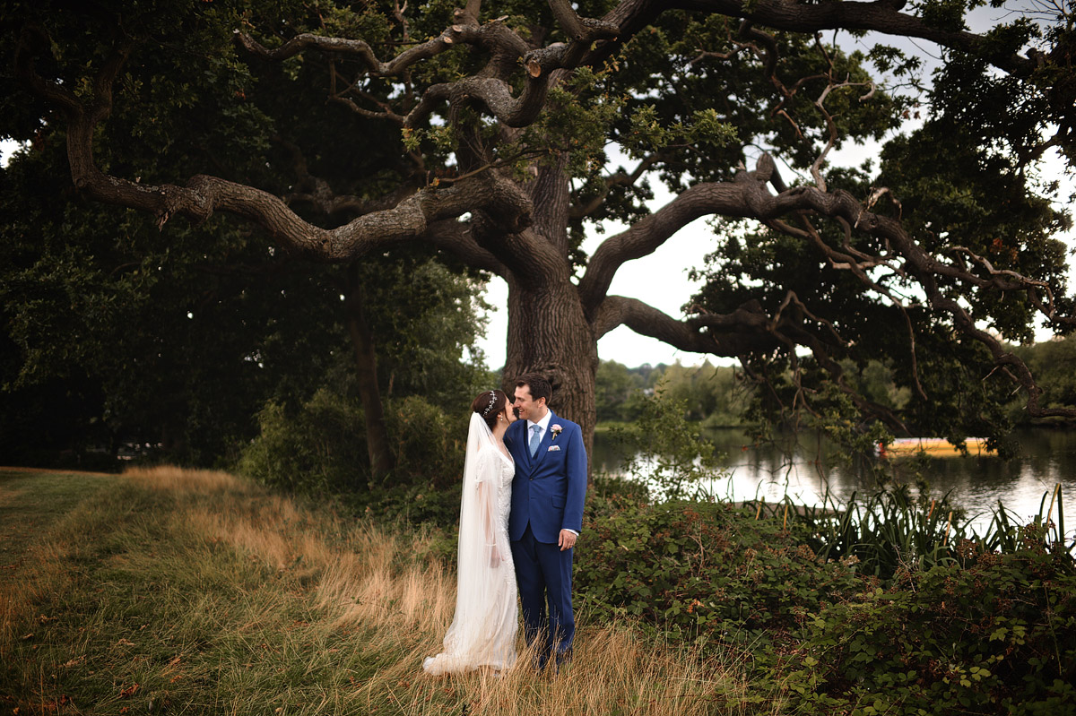 Wedding photographer London - couple portrait with tree in wimbledon wedding