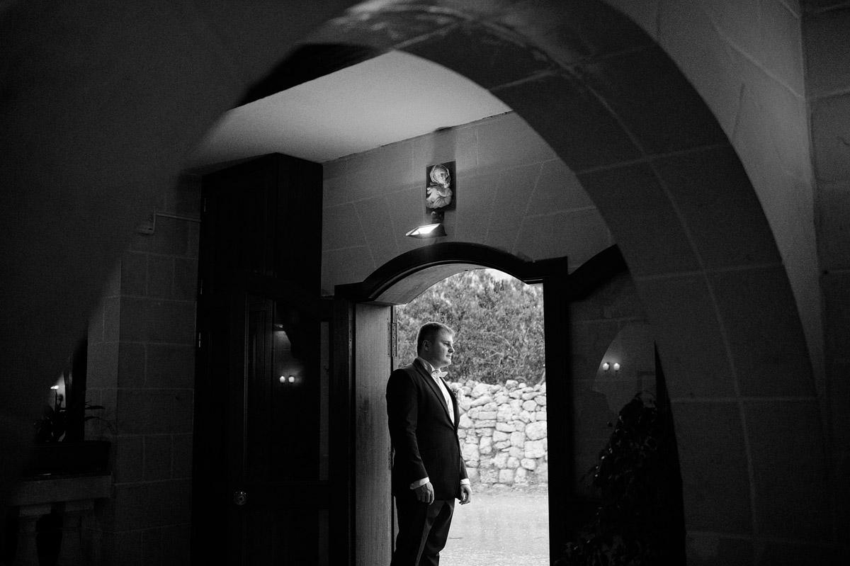 Groom waiting for bride at Olive Garden wedding