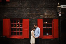 London engagement photography with red coloured window