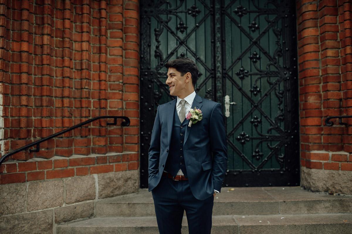 Groom waiting for bride to arrive in Berlin