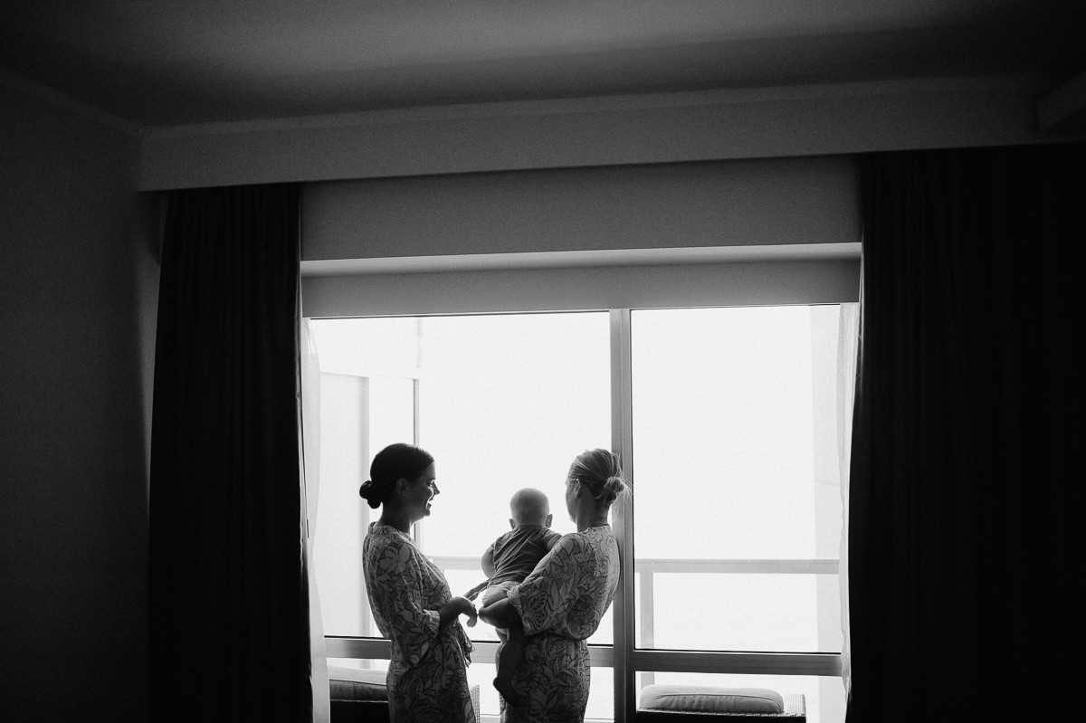 wedding in Malta, black and white image of a baby and two giirls