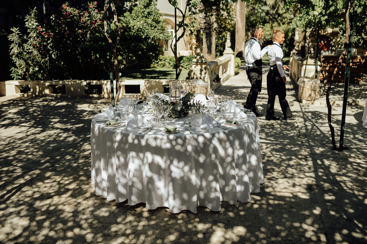 reception table laid nicely in shade