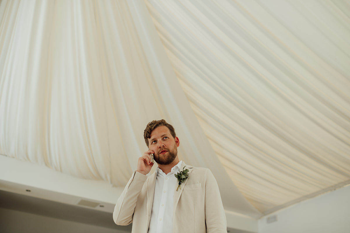 groom and mobile phone