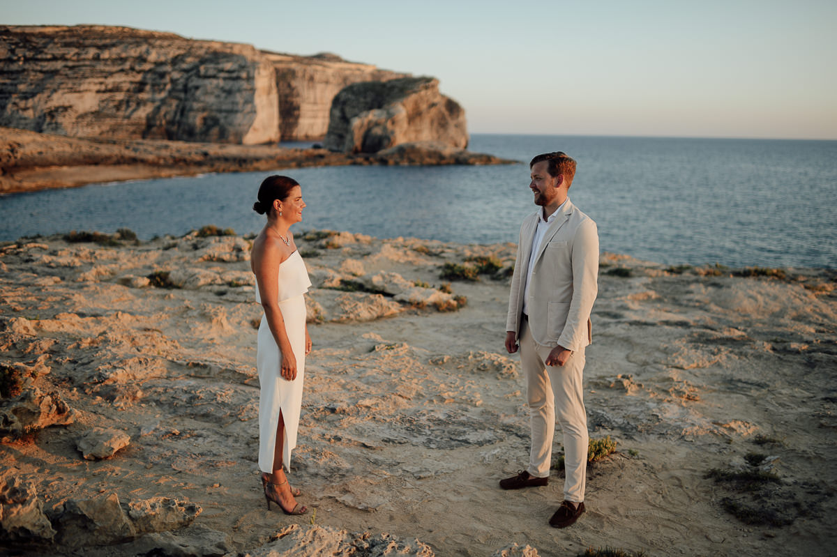 wedding couple portraits by the sea in sunset in Gozo Malta Dwejra