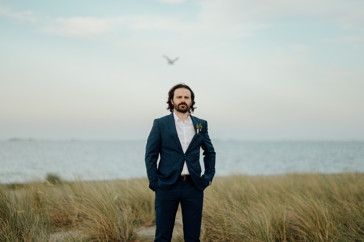 groom portrait at Copenhagen beach