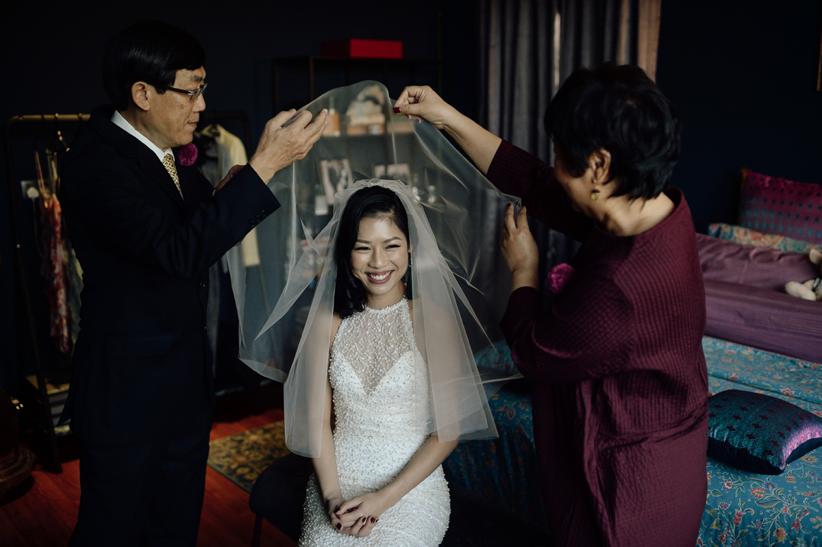 Parents putting the wedding veil on bride in Singapore wedding