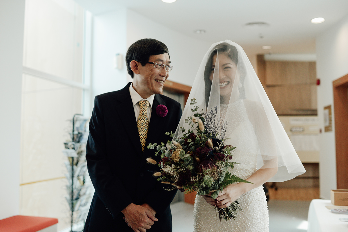 Bride and her father about to enter the church in Singapore wedding