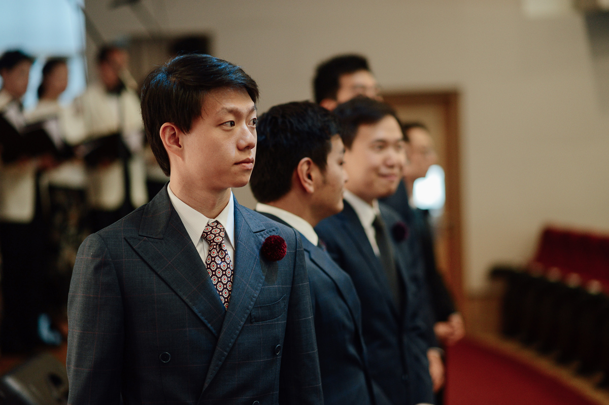 Groom waiting in St James church in Singapore wedding