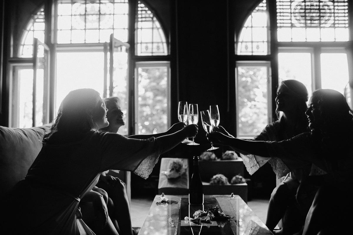 Bridesmaids cheers in beautiful villa