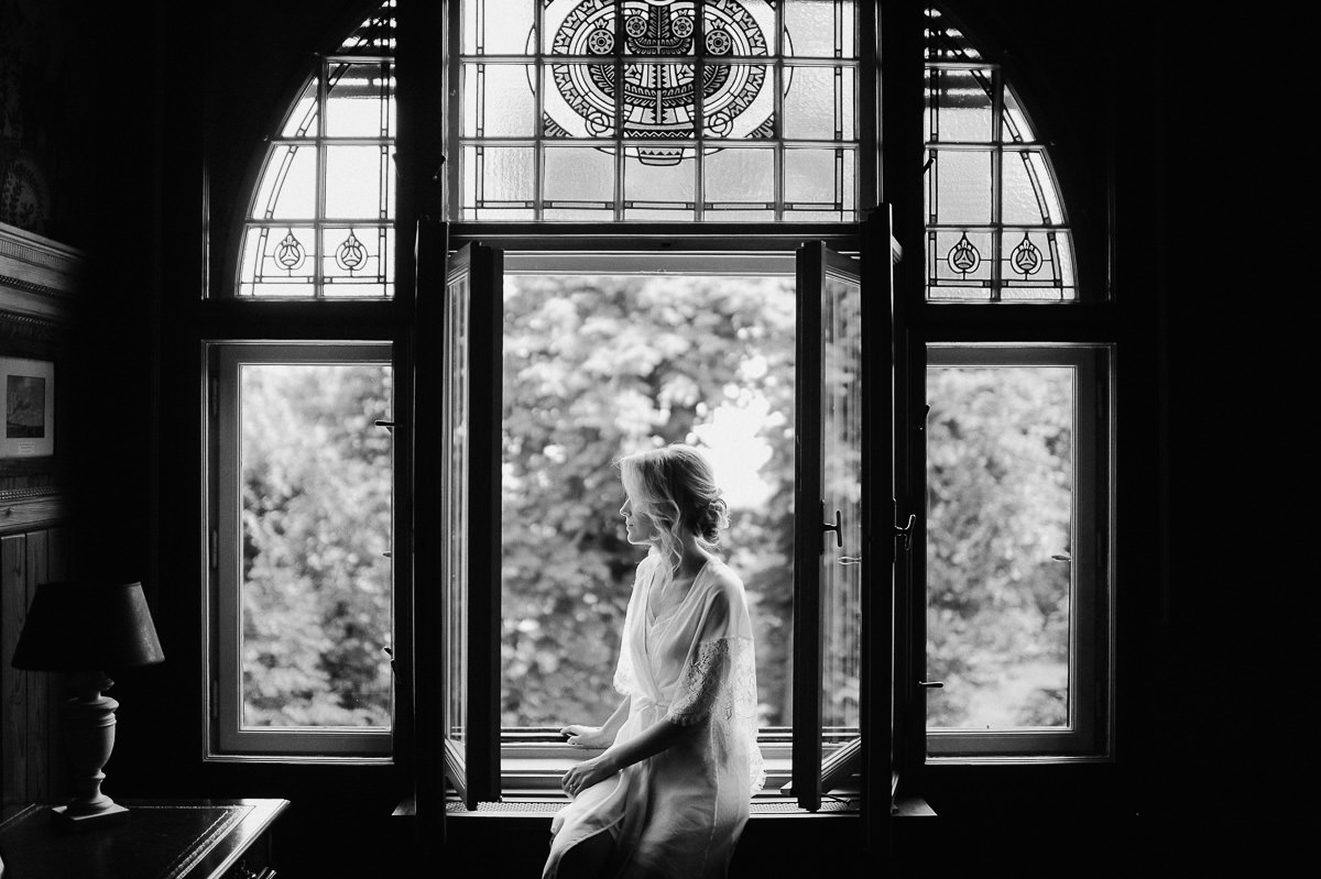 Bride portrait in window light In Writer 's Villa