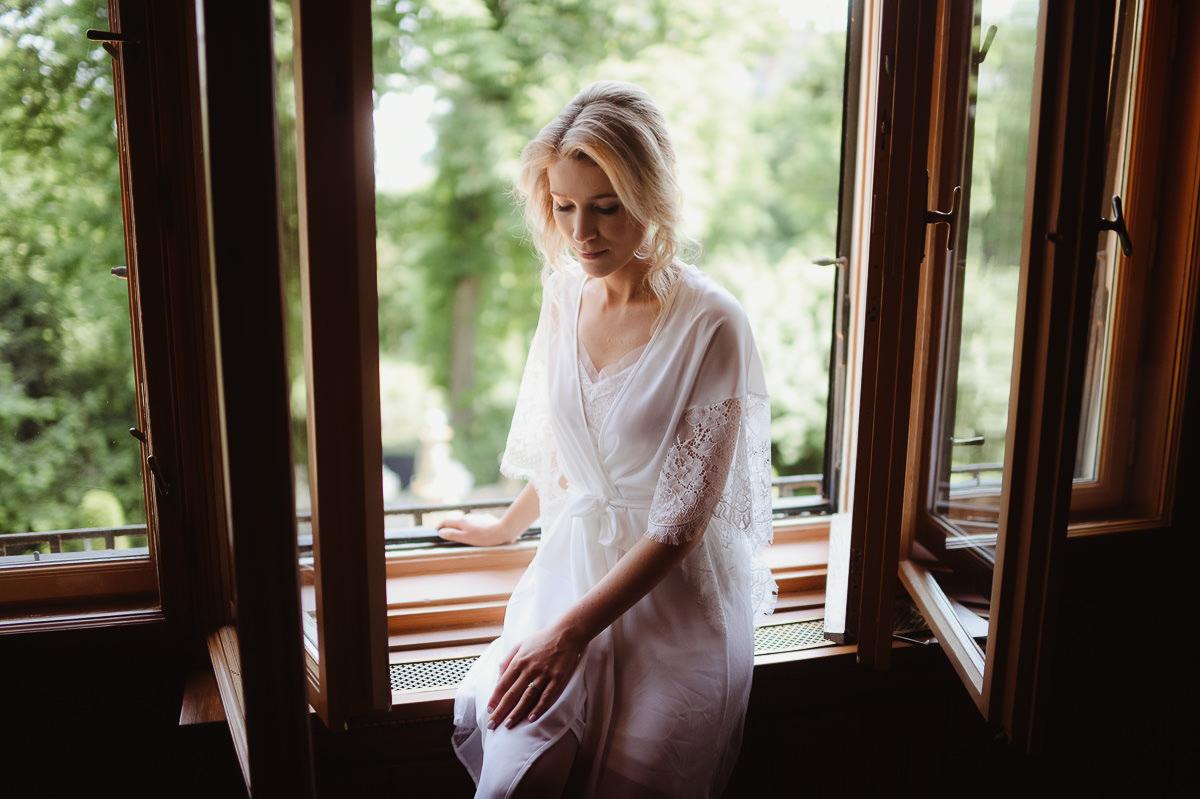 Bride portrait in window light In Writer 's Villa