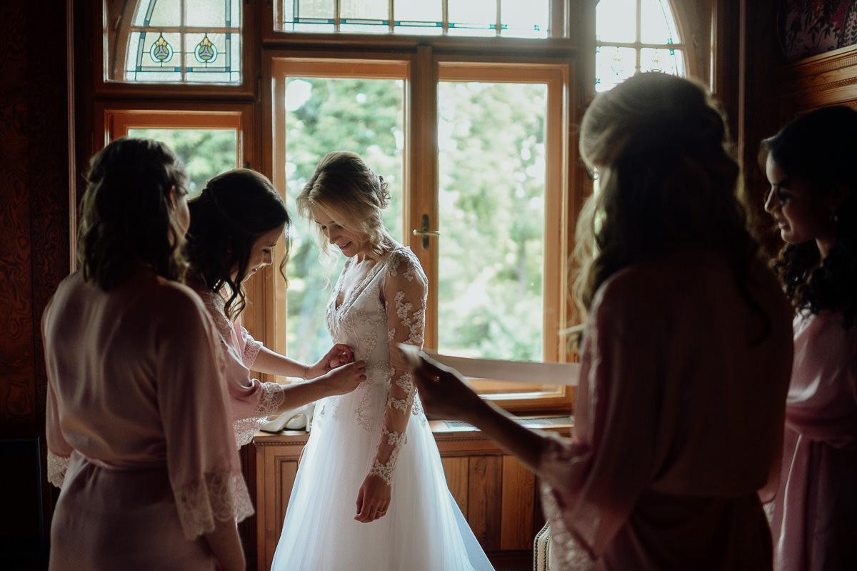 Bride getting dressed in Writer's villa