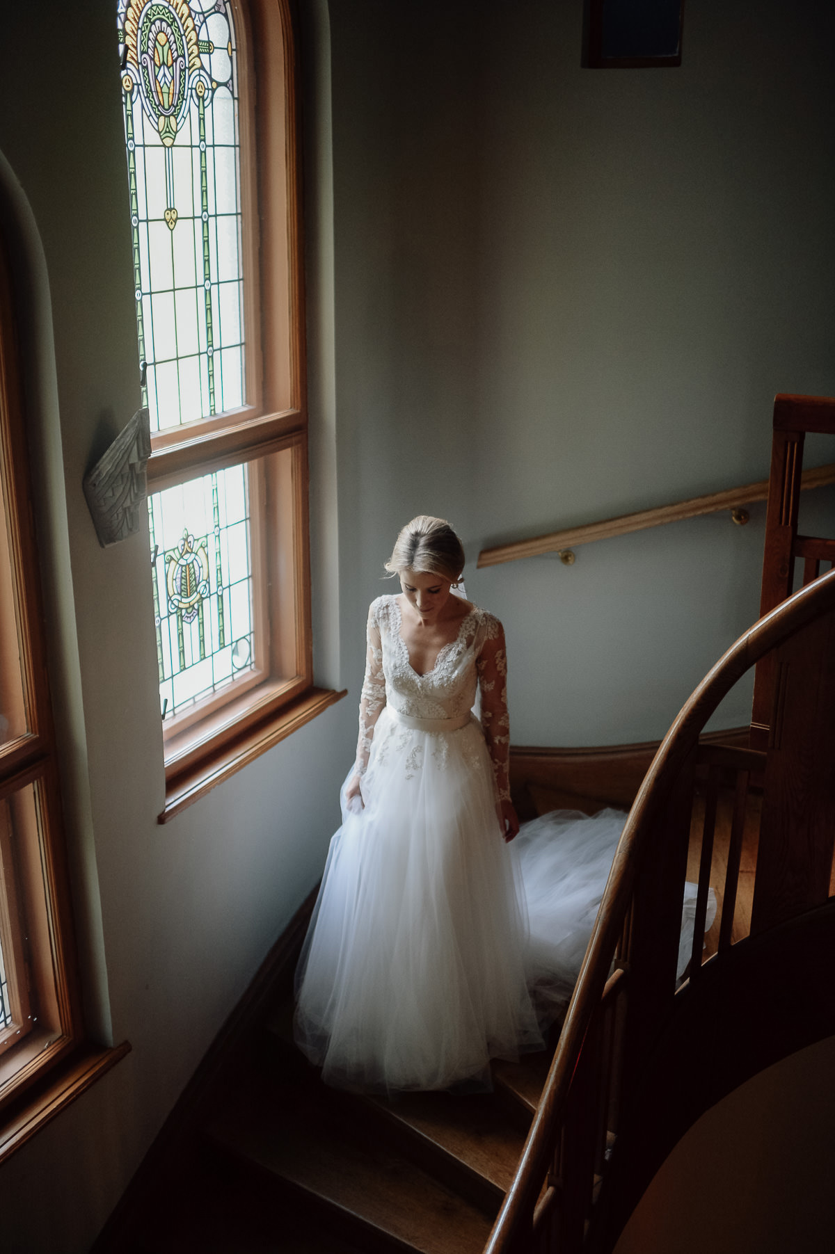 bride walking down the stairs in Writer's Villa Wedding