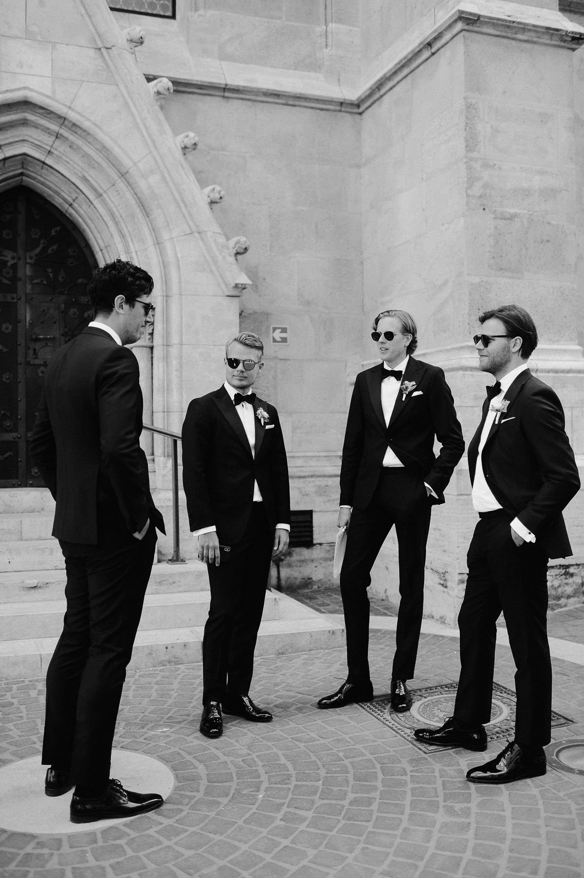 Groomsmen standing in front of St Matthias church Budapest