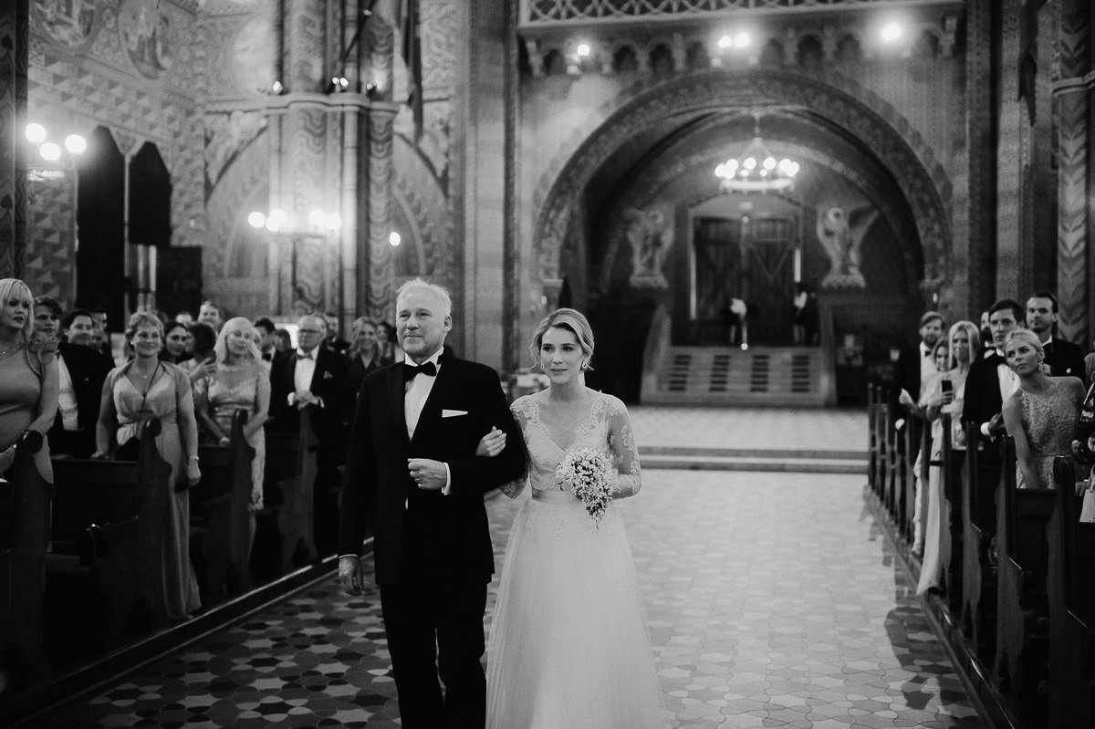 Bride and her father walking down the aisle in St Matthias church Budapest wedding