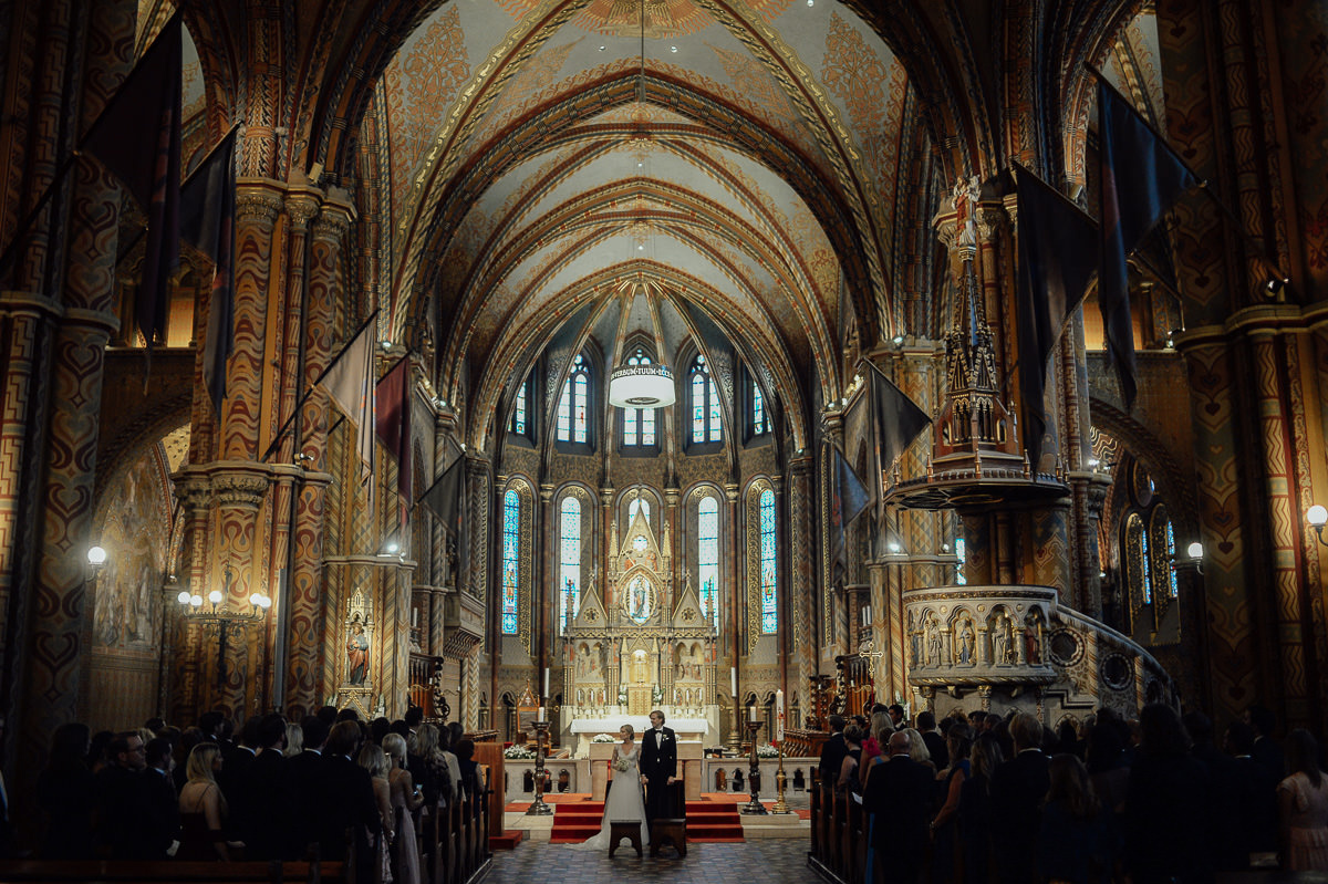 Bride and groom getting married in St Matthias church Budapest