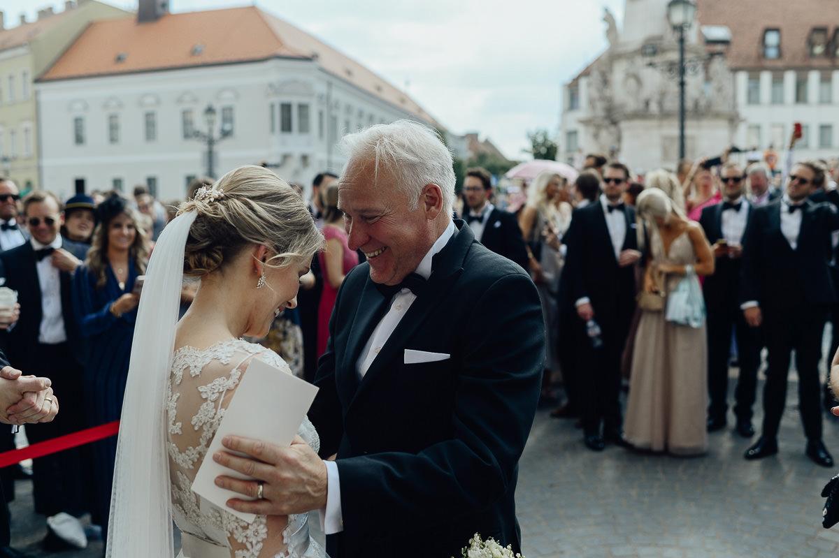Father congratulates bride at St Matthias Church