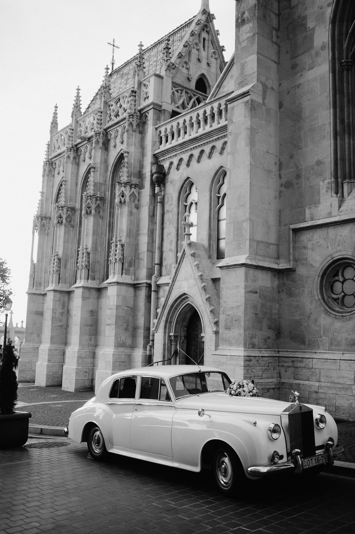 Wedding couple leaving St Matthias Church in Old timer Rolls Royce