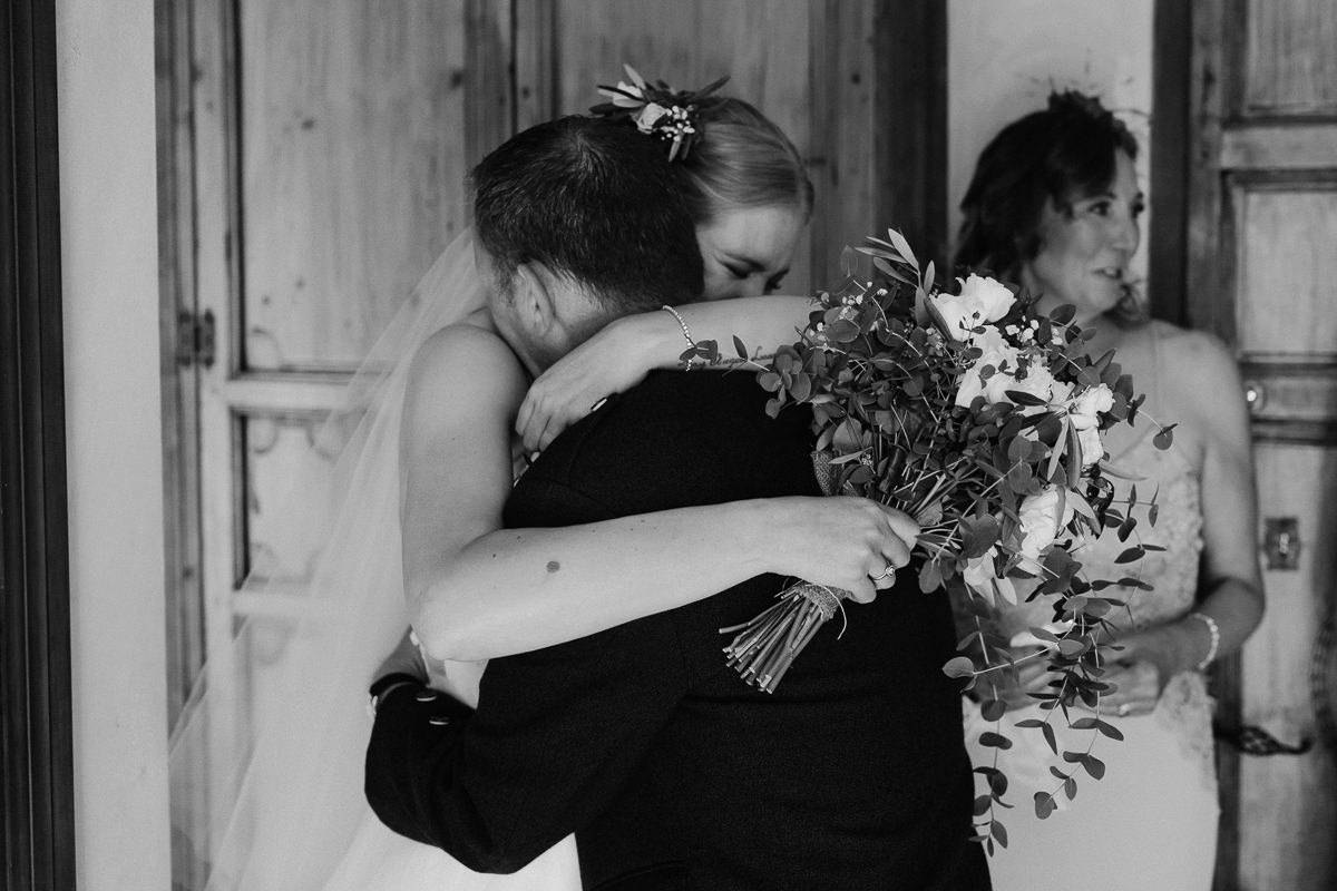 Father of the bride and Bride hugging