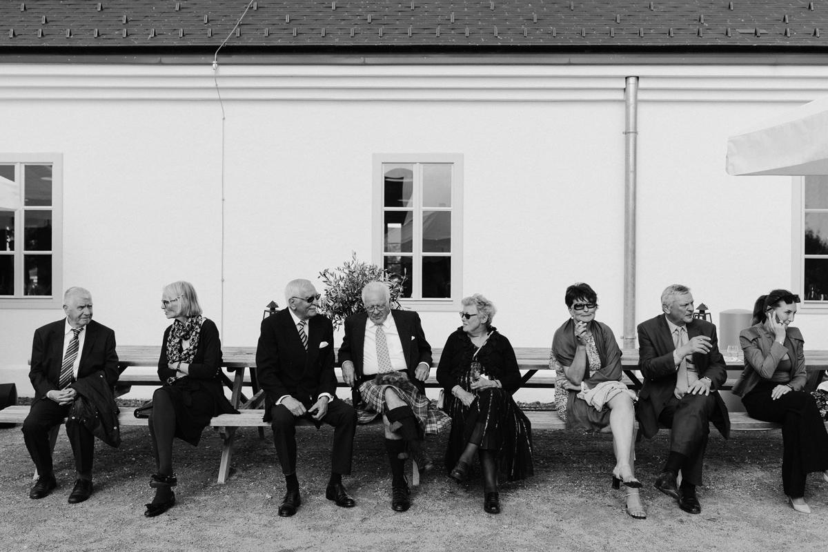 wedding guest sittin at Kalandahaus Esterhazy Winery wedding reception