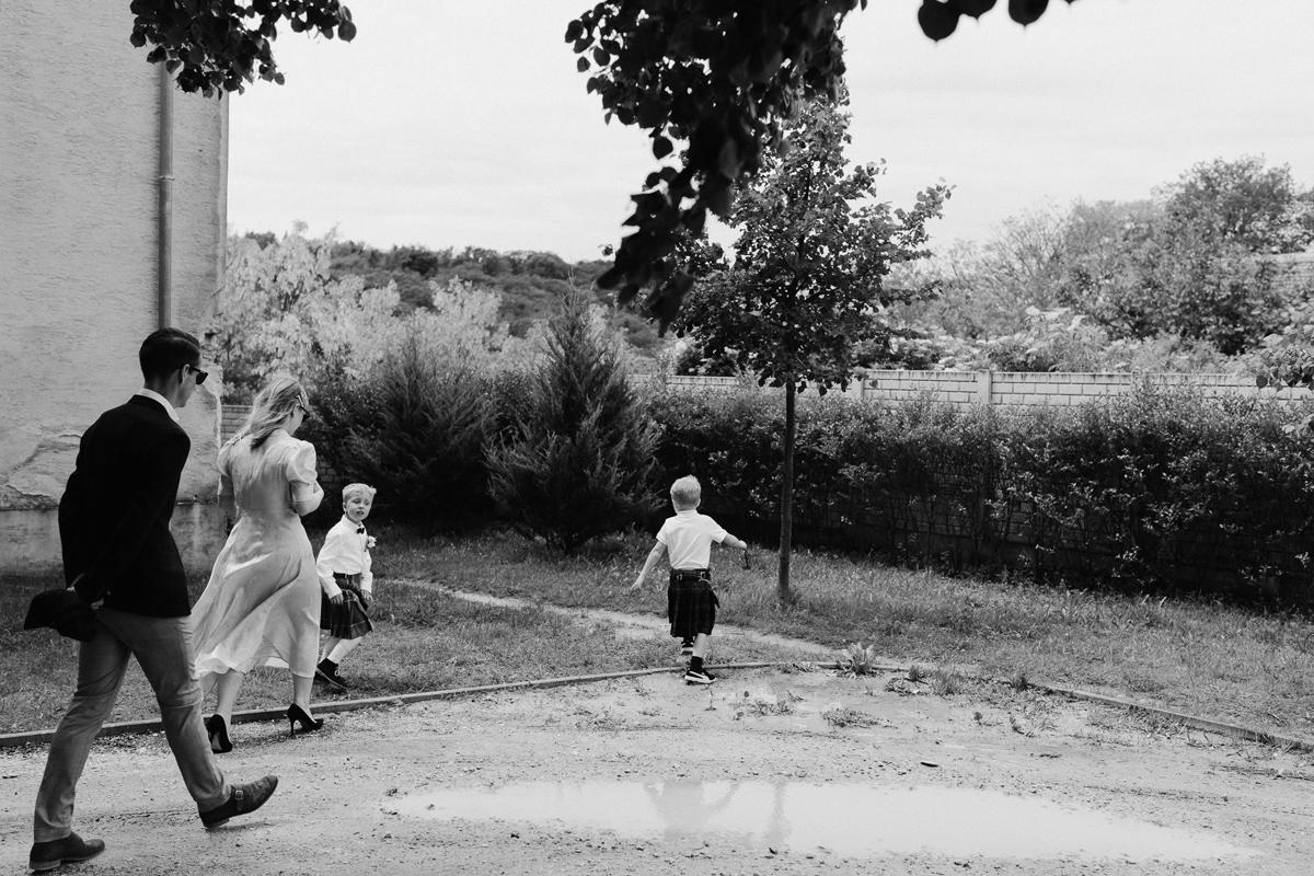 Scottish kids at wedding running