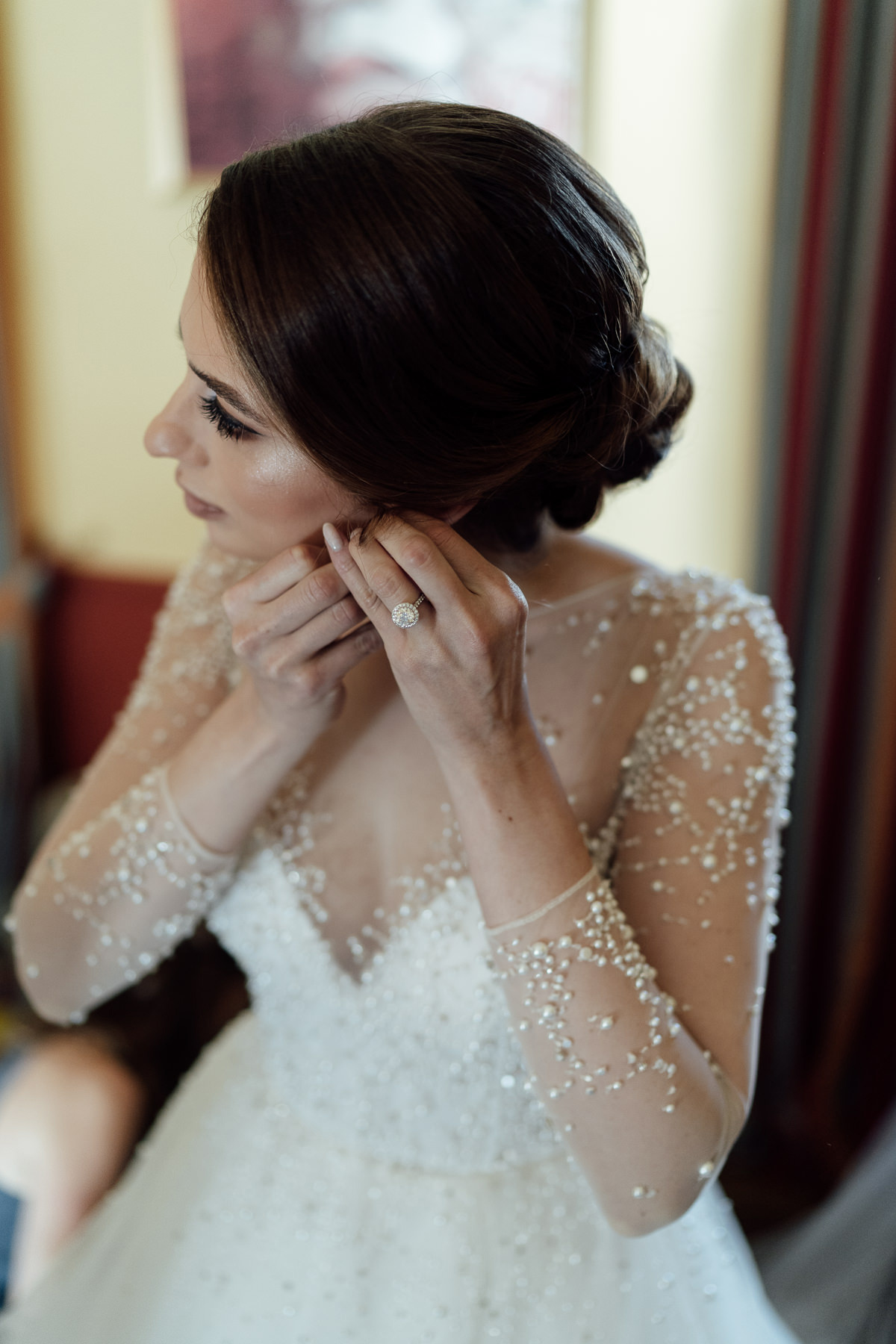 Bride putting on Hayley Paige wedding gown in Chateau Bela Hotel