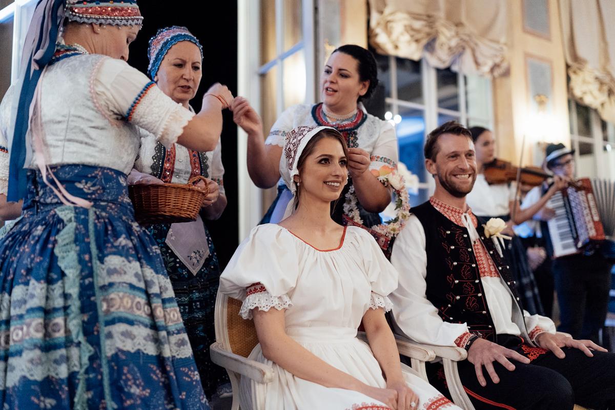 Traditional cepcenie bonnet ceremony Slovakia Chateau Bela