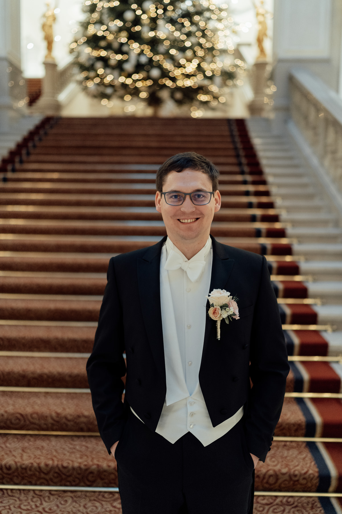Groom waiting for bride grand staircase Corinthia