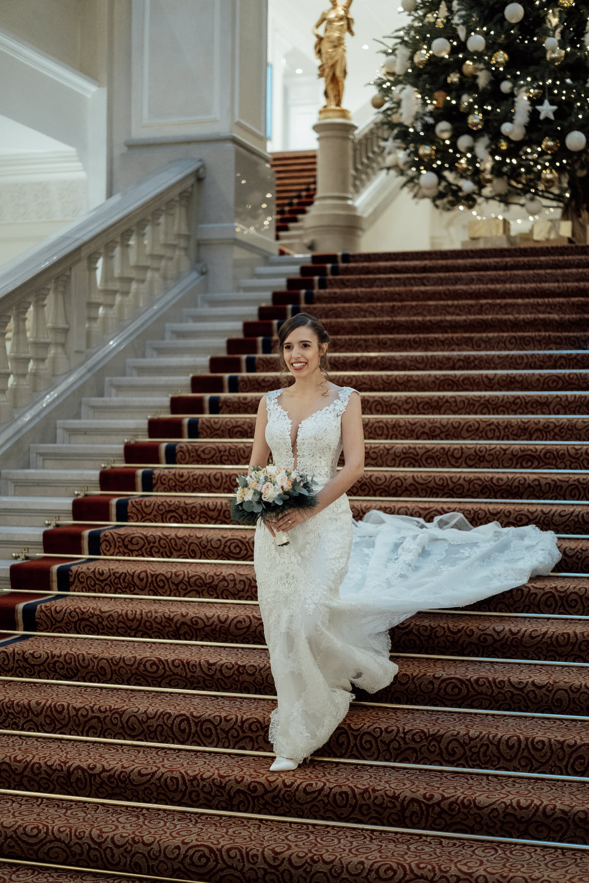 Bride portrait on staircase in Corinthia