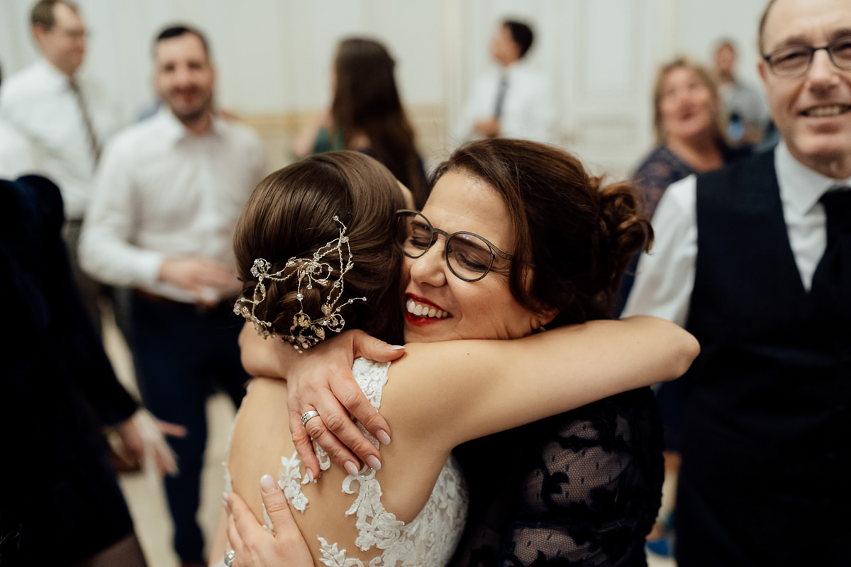 Bride and her Mum hugging