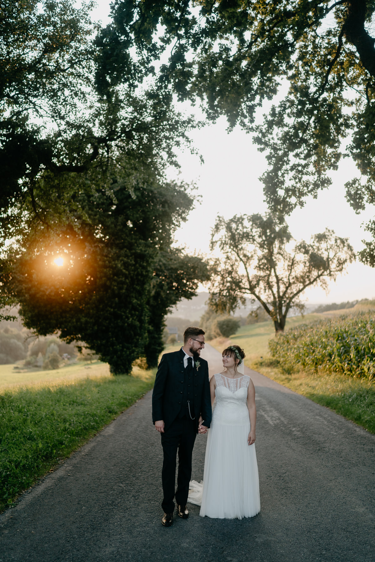 Wedding couple in the middle of the road at sunset in Austria